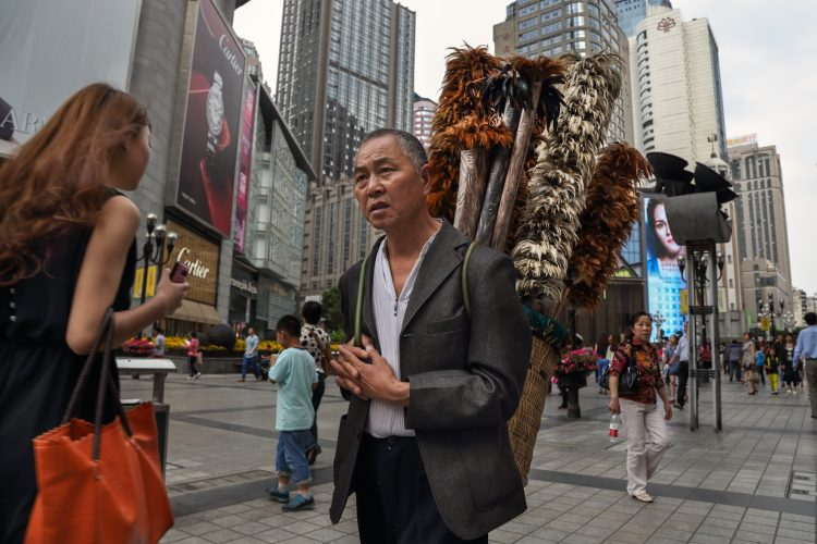 Former farmer sells feather broom in urban China