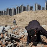 Li Rui, 60, scavenges his former village -- now bulldozed into a giant construction site -- for building materials in Liaocheng in the northeastern Chinese province of Shangdong.