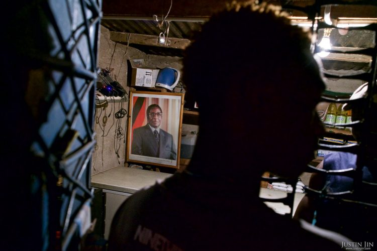 A portrait of Zimbabwean President Robert Mugabe hangs in a shop near Harare. Pictures shot by Justin Jin