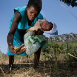 Liliosa, 16, forages for wild fruits in Masvingo Province, Zimbabwe, to feed herself, her baby and her young sister, who is born HIV positive. Drought in southern Africa is devastating communities in Zimbabwe, leaving 4 million people urgently in need of food aid. The government declared a state of emergency,. Here in Masvingo Province, the country's hardest hit province, vegetation has wilted, livestock is dying, and people are at serious risk of famine.