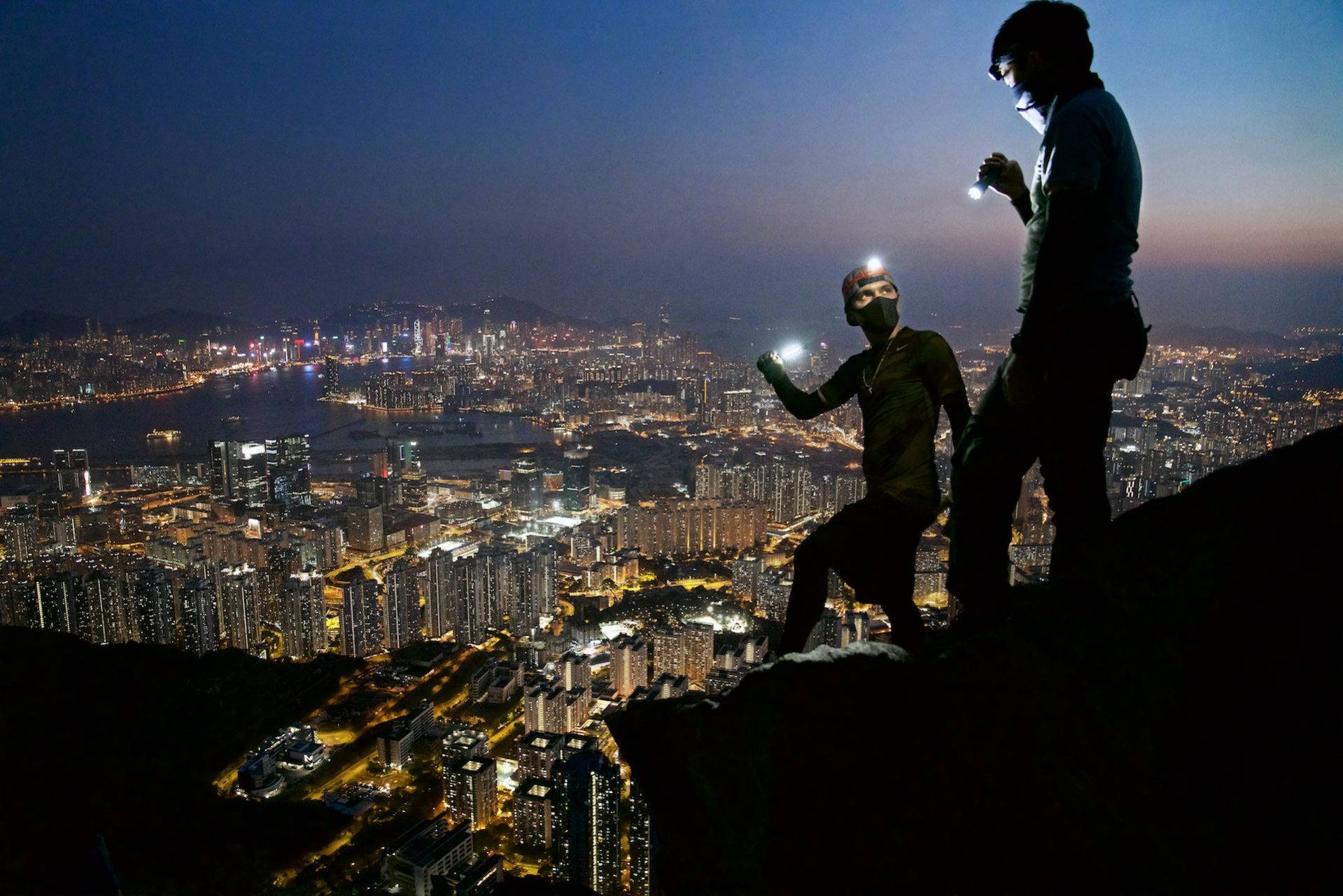 Members of Urbex, or Urban Explorers, explore Hong Kong's cityscape.